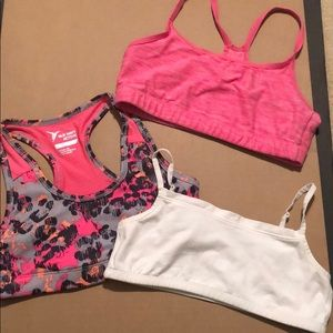 Three Sports bras, Gap and Old Navy